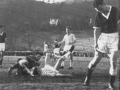 Willie Bauld watches Alan Gordon (on ground) scoring one of his goals during the Scottish Cup tie at Victoria Park.